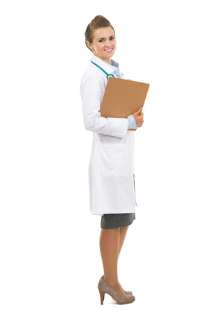 Full length portrait of smiling doctor woman with clipboard Stock Photo - 21567994