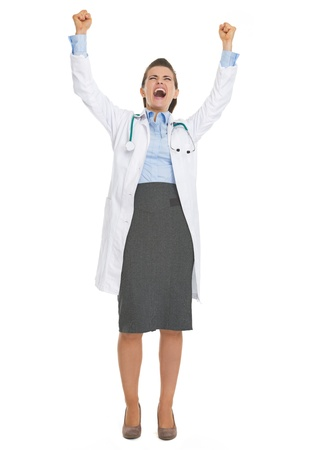 Full length portrait of happy doctor woman rejoicing success Stock Photo - 21568215