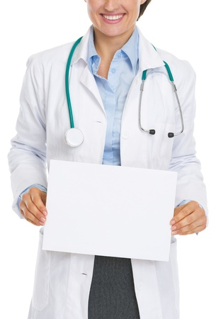 Closeup on smiling doctor woman showing blank paper sheet Stock Photo - 21568218