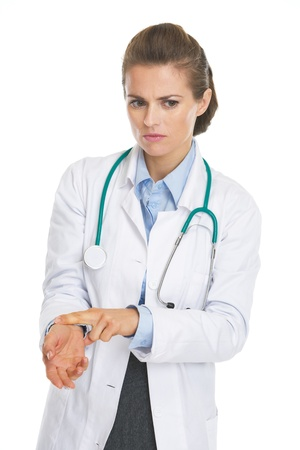 disquieted: Concerned doctor woman checking pulse
