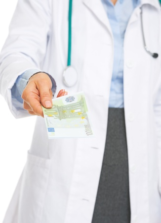 Closeup on doctor woman giving euros Stock Photo - 21568277