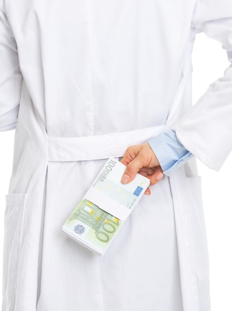 Closeup on doctor woman hiding stack of dollars behind back Stock Photo - 21511432