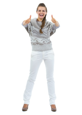 Full length portrait of happy young woman in sweater showing thumbs up Stock Photo - 21792265
