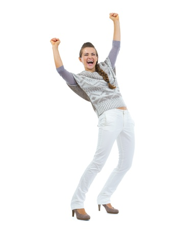 Full length portrait of happy young woman in sweater rejoicing success photo