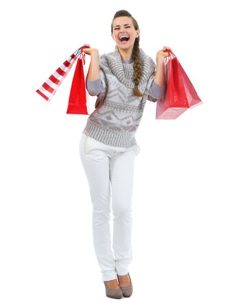 Full length portrait of happy young woman in sweater with christmas shopping bags Stock Photo - 21792294