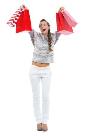 rejoicing: Happy young woman in sweater with christmas shopping bags rejoicing Stock Photo