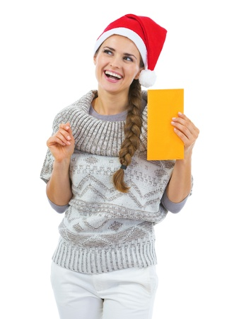 Thoughtful young woman in sweater and christmas hat holding letter Stock Photo - 21792339