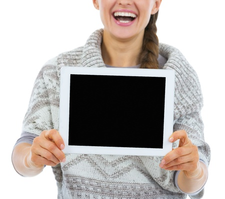 topicality: Closeup on smiling young woman showing tablet pc blank screen