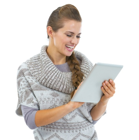topicality: Happy young woman in sweater using tablet pc