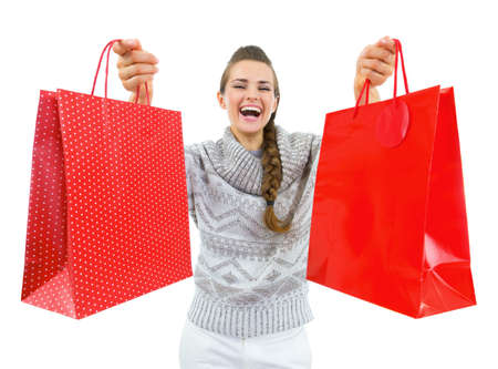 Happy young woman in sweater showing christmas shopping bags Stock Photo - 21707586