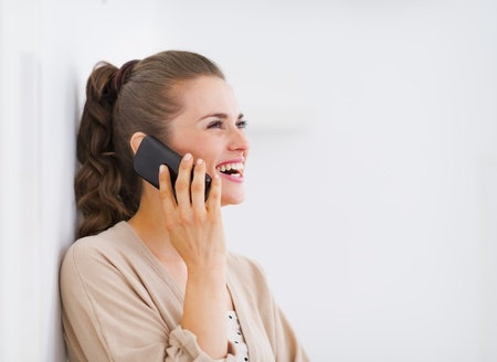 Happy young woman talking mobile phone and looking on copy space Stock Photo - 21792462