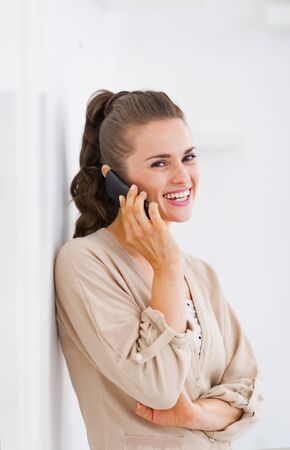 Smiling young woman talking cell phone Stock Photo - 21792464