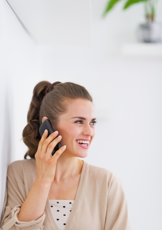 Happy young woman talking mobile phone Stock Photo - 21792476