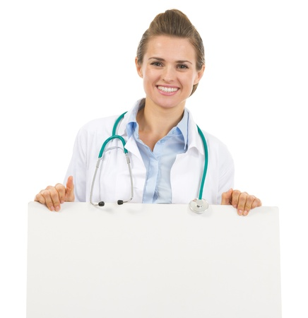 Smiling doctor woman showing blank billboard photo