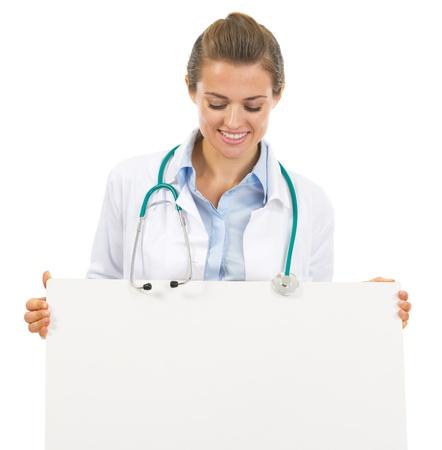 Happy doctor woman looking on blank billboard Stock Photo - 21896923