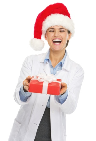 heal new year: Happy doctor woman in santa hat giving christmas present box Stock Photo