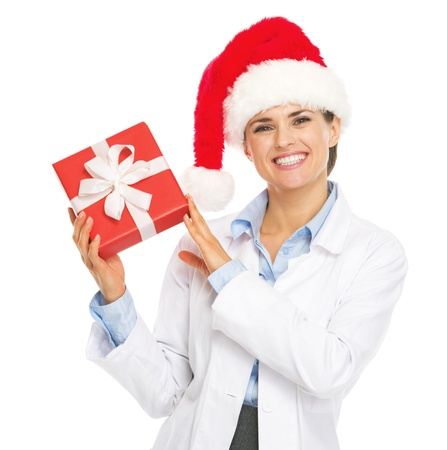 heal new year: Happy doctor woman in santa hat showing christmas present box Stock Photo