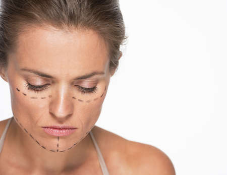 disquieted: Concerned woman with plastic surgery marks on face Stock Photo