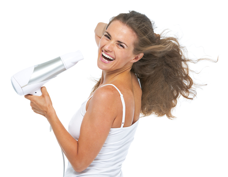 Portrait of happy young woman blow-dry photo
