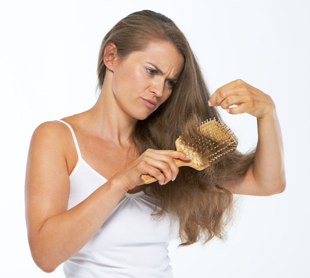 Frustrated woman looking on hair ends