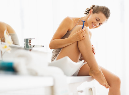 razor: Happy woman checking legs after shaving