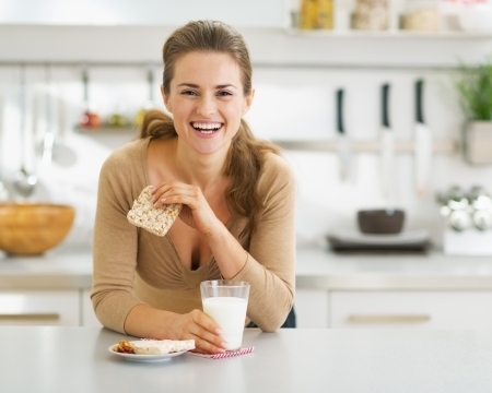 galettes: Smiling young woman having healthy breakfast