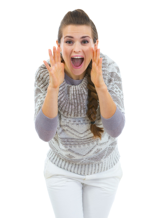 Young woman in sweater shouting through megaphone shaped hands Stock Photo - 22514248