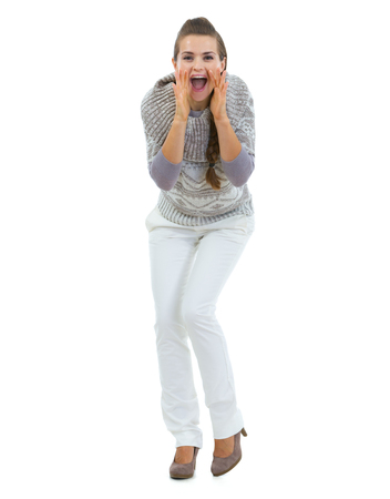 Full length portrait of happy young woman in sweater shouting through megaphone shaped hands Stock Photo - 22518696
