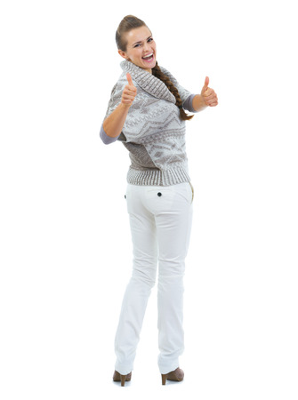 Full length portrait of happy young woman in sweater showing thumbs up Stock Photo - 22514253