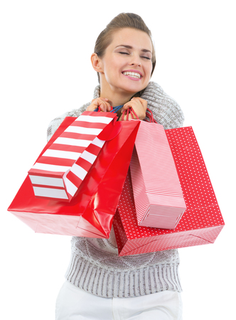 Happy young woman in sweater with christmas shopping bags Stock Photo - 22514255