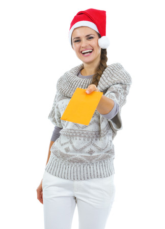 Smiling young woman in sweater and christmas hat giving letter Stock Photo - 22514261