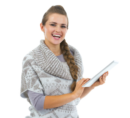 topicality: Smiling young woman in sweater using tablet pc