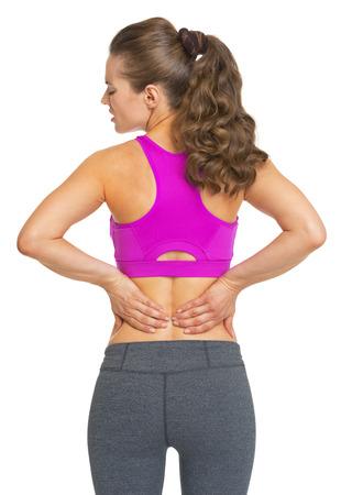 Female athlete having backache photo
