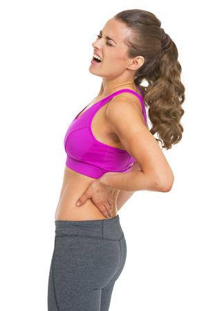 mujeres de espalda: Fitness mujer joven que tiene dolor de espalda