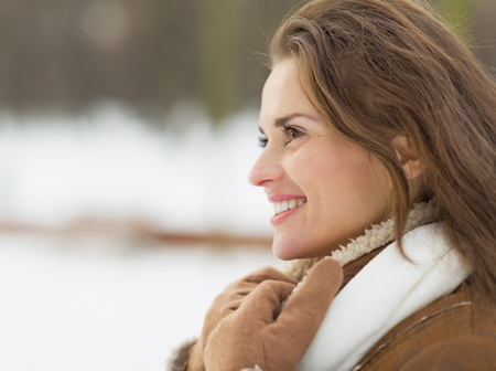 citypark: Portrait of happy young woman in winter outdoors