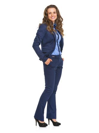 Full length portrait of smiling business woman Фото со стока