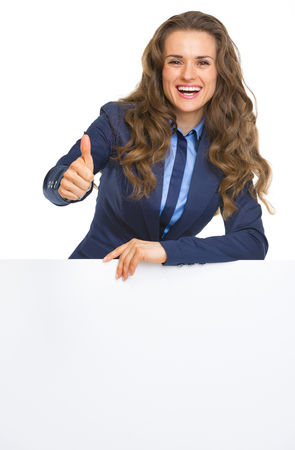 Smiling business woman showing blank billboard and thumbs up Stock Photo - 22665282