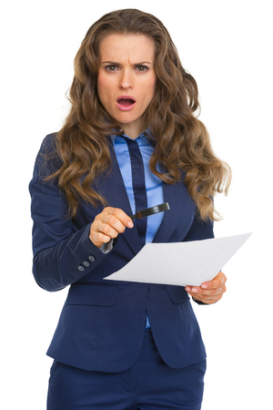 suspiciousness: Surprised business woman with magnifying glass and document