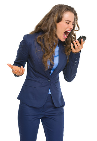 Angry business woman shouting in cell phone photo