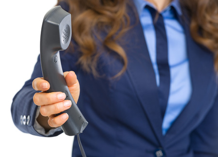 Closeup on business woman giving phone handset Stock Photo - 22641409
