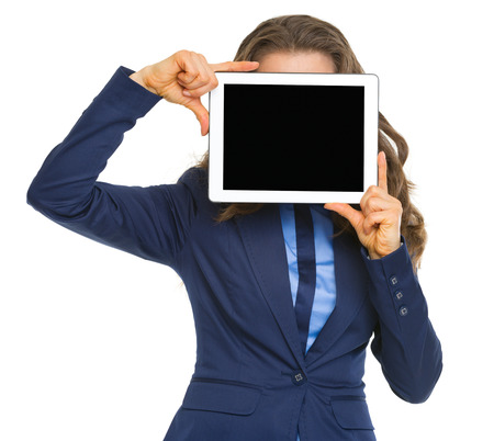 topicality: Business woman holding tablet pc with blank screen in front of face