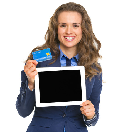 topicality: Smiling business woman holding tablet pc blank screen and credit card Stock Photo