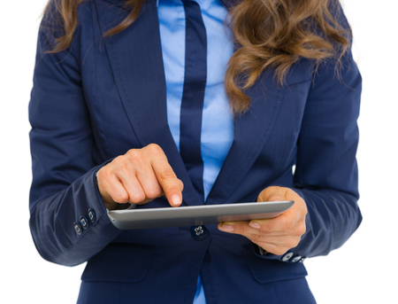 topicality: Closeup on business woman using tablet pc Stock Photo