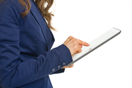 topicality: Closeup on business woman working on tablet pc