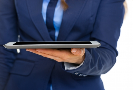 topicality: Closeup on business woman holding tablet pc Stock Photo