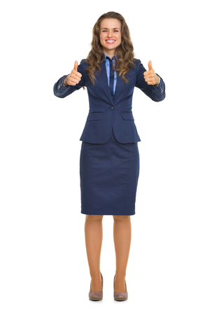 Full length portrait of smiling business woman showing thumbs up photo