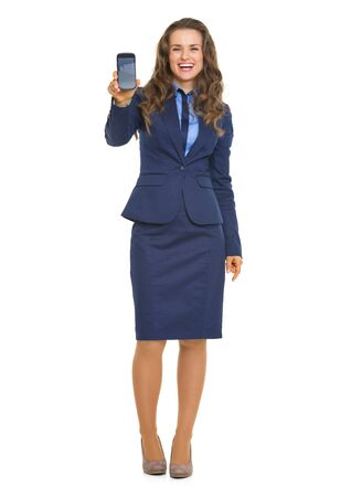 topicality: Full length portrait of smiling business woman showing cell phone