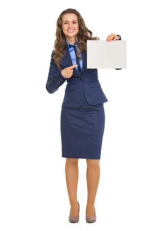 Full length portrait of smiling business woman pointing on blank billboard Stock Photo - 22665495