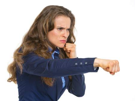 Serious business woman punching