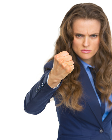 Angry business woman threatening with fist Stock Photo